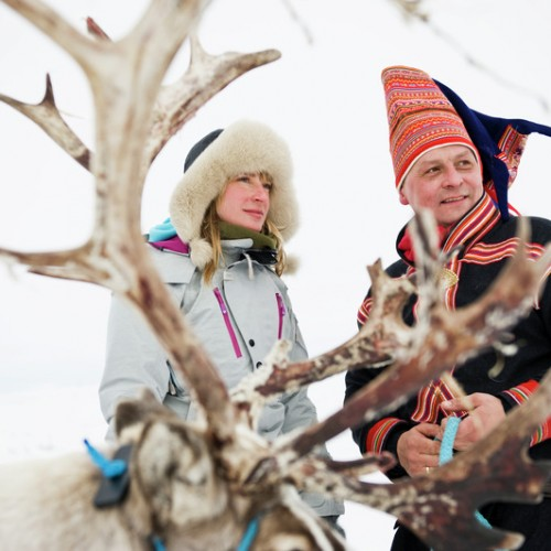 Woman-and-Sami-man-with-reindeer-Finnmark-Norway